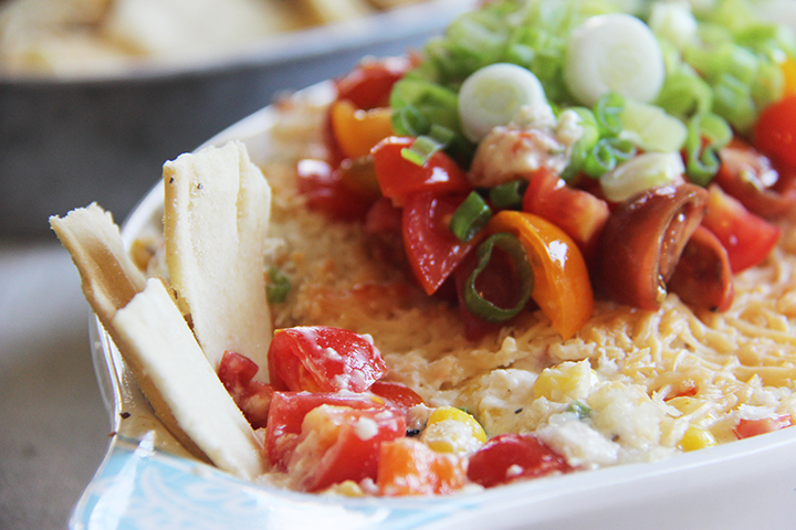 Spicy Cheesy Corn Dip is festive, fun, and oh so delicious!