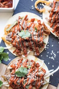 Slow Cooker Beef Tacos or Bulgogi Tacos are packed with flavor, no messy cleanup, and zero effort! Seriously, it doesn't get easier than that! And the best part, you can make it in a slow cooker or on a grill.