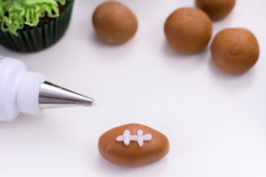 Football Cupcakes are the perfect dessert for Super Bowl parties, football game day, or a themed football birthday party!