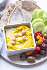 Coconut, curry, and chickpeas come together to create an unforgettable Thai Coconut Curry Hummus that will leave you craving the flavor for days after trying it!