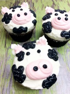 The cutest Moo-Cow Cupcake! Perfect for a barnyard themed birthday party or county fair and they will be a hit among kids. Follow these simple step-by-step instructions to create an udder-ly adorable cow cupcake.