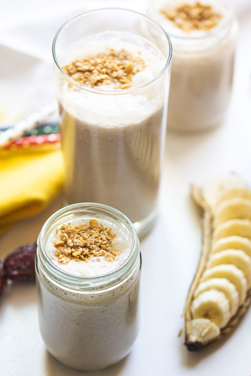 Easy Healthy Banana Smoothie made with 4 ingredients! Naturally sweetened with dates, this simple smoothie is good for a snack or a healthier dessert. So smooth and creamy, this fresh smoothie is refreshing, delicious, and perfect for a busy family.