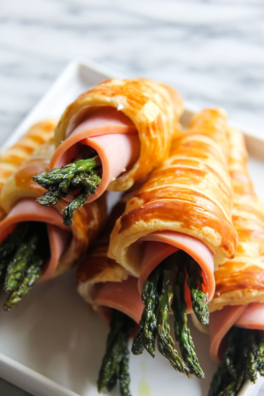 The puff pastry cone is a crunchy perfection that your family & friends will love! Here's to savoring the beginning of Summertime with Creamy Asparagus Puffs!