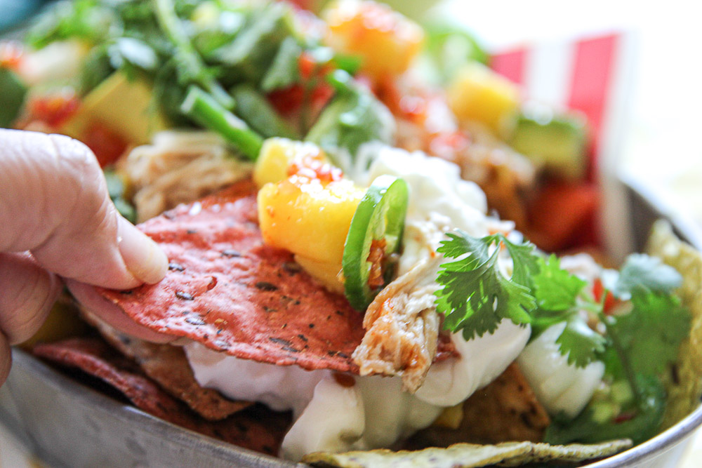 Heading to a labor day picnic this weekend and don't know what to make? Bring the tropical flavor to your friends with these delicious Kalua pork nachos!