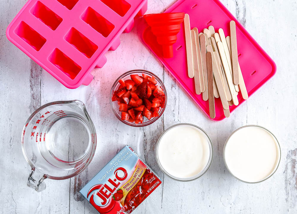 These Keto Strawberry Popsicles are frozen treats to keep you cool in the heat. Super fast and easy, these homemade pops are a fun alternative to store-bought frozen treats.