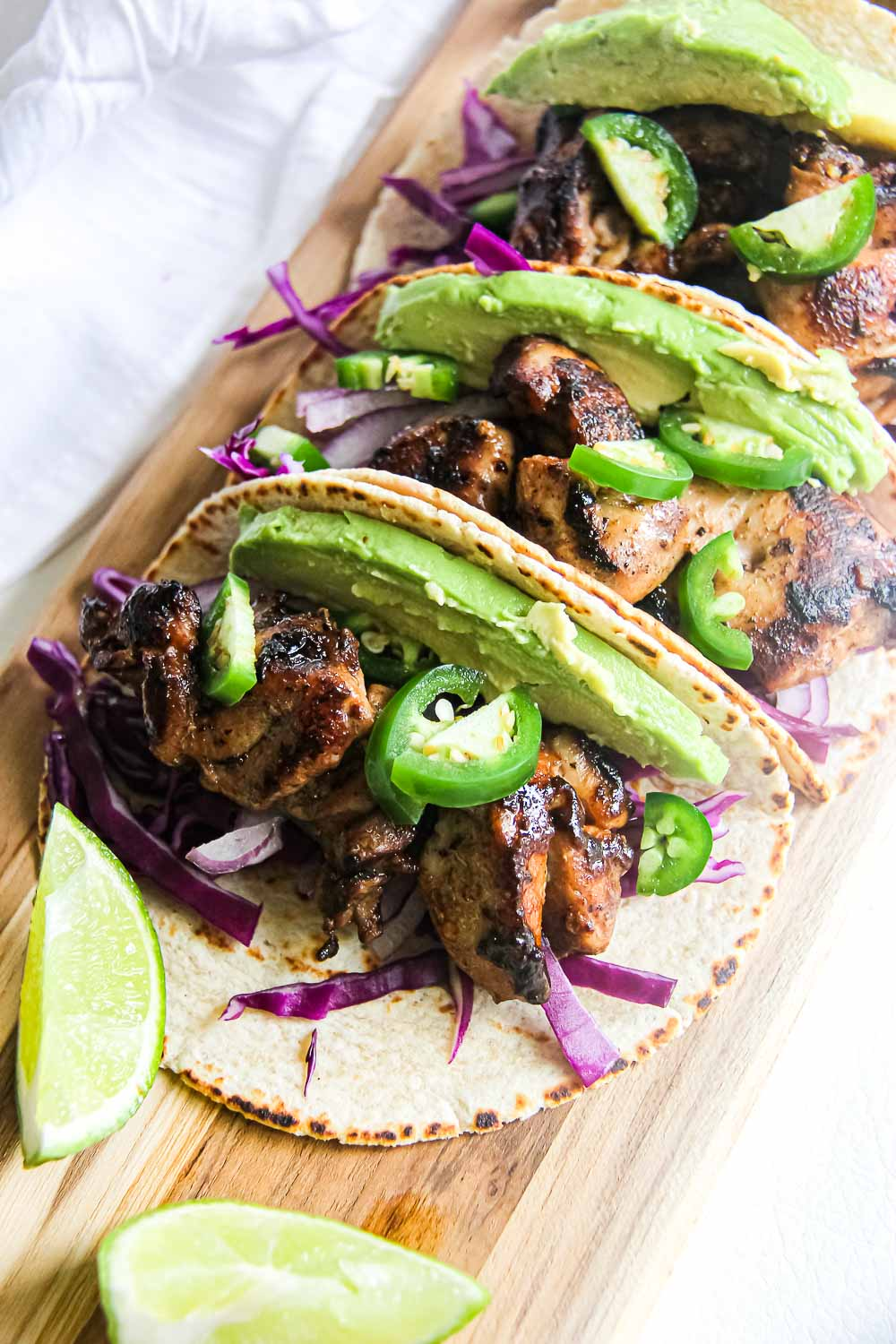 Kick your Taco Tuesday or Cinco de Mayo up a notch with these pineapple lime chicken tacos that are hearty and full of flavors!