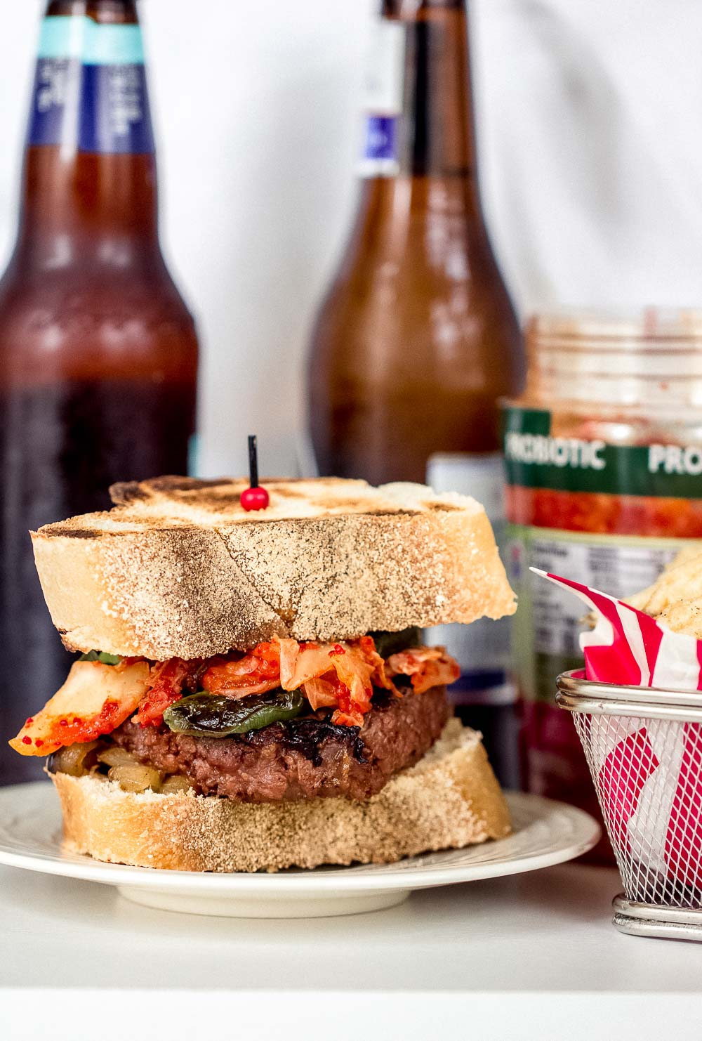 Trying to eat more plant-based food but don't want to give up your favorite dishes? Then you've got to try this Plant-Based Kimchi Burger! A flavorful twist on a classic that you must try.