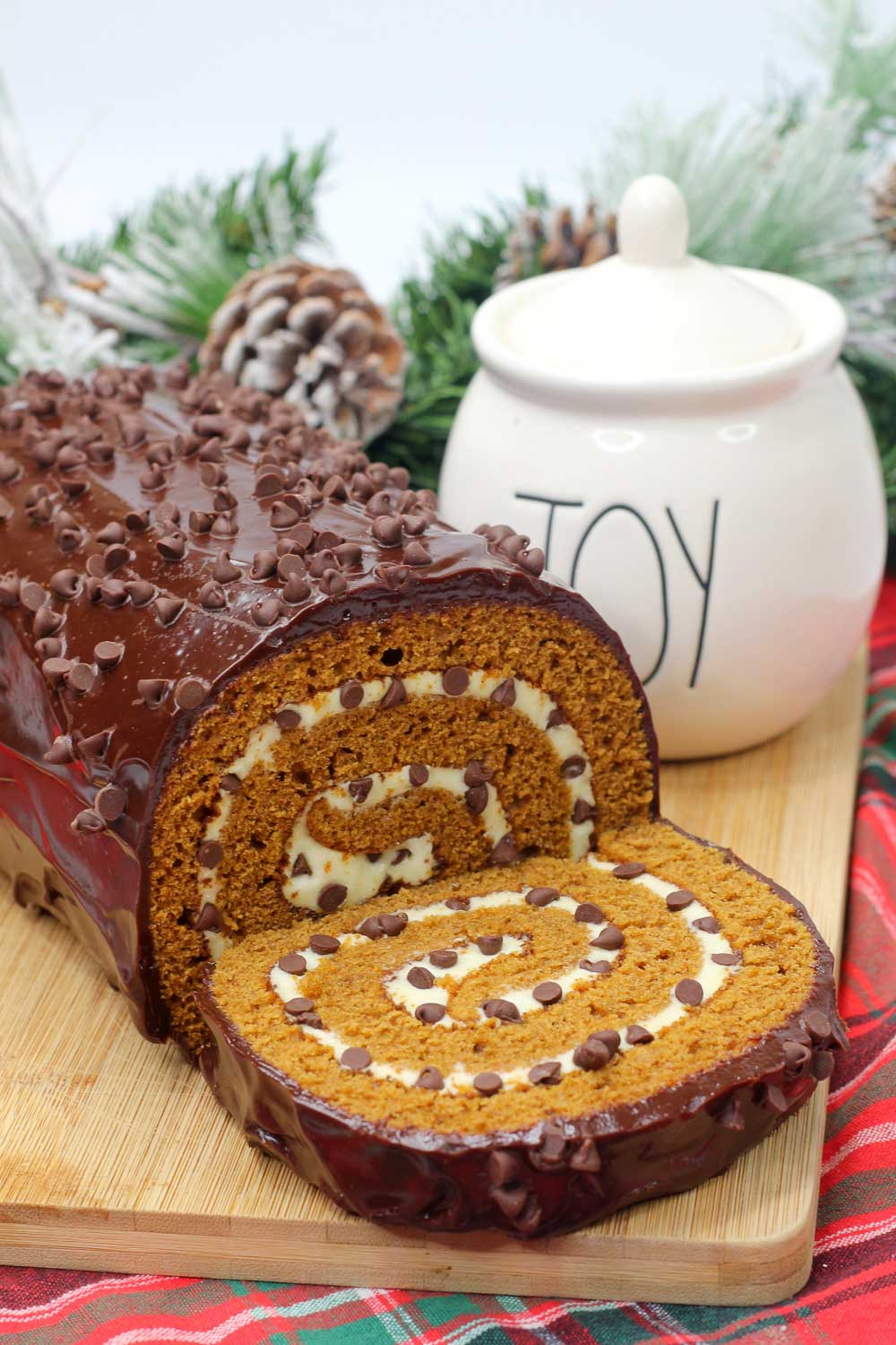 A nod to the classic childhood favorite, this chocolate pumpkin cheesecake roll combines a spongy, fluffy pumpkin cake with cheesecake filling and covered in chocolate ganache. Light and rich, this cake is for chocolate lovers everywhere.