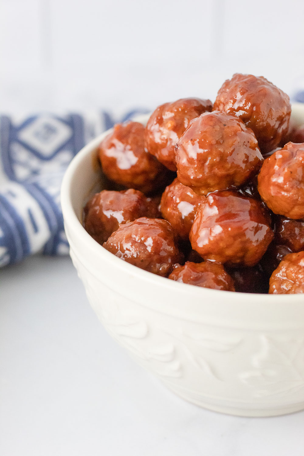 Sticky, a touch spicy, juicy and so tasty! These Slow Cooker Party Meatballs make the perfect party appetizer or quick family dinner.