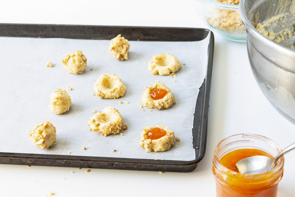 These classic Apricot Walnut Thumbprint Cookies are so delicious you'll want to make them all year. These thumbprint cookies are adorable and melt in your mouth!