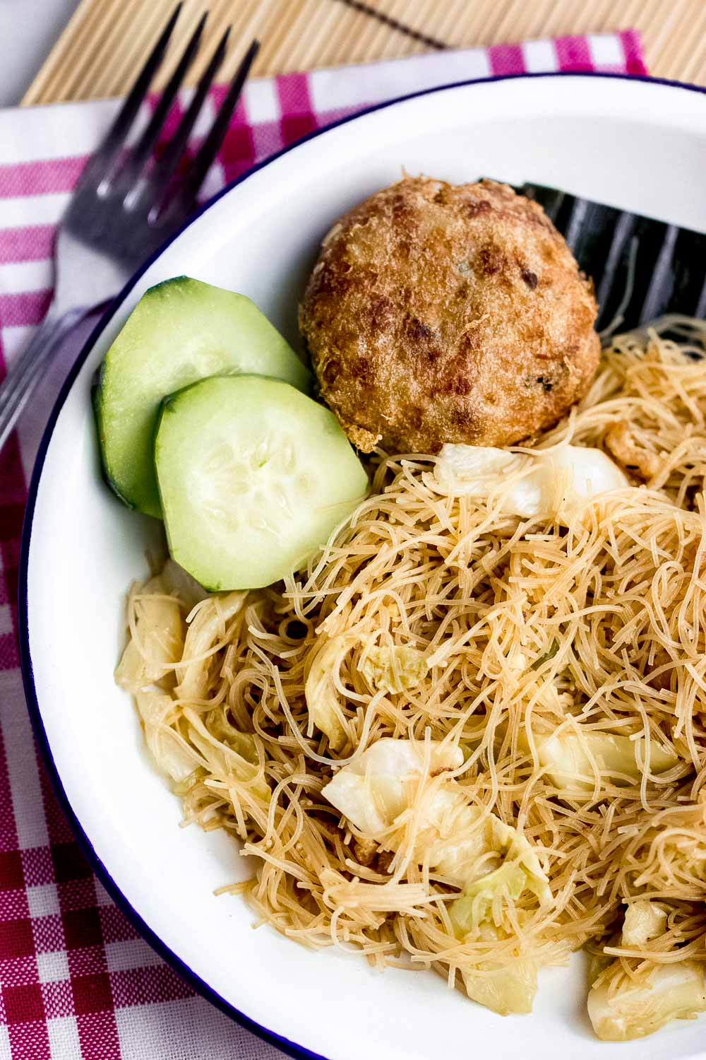 If you're looking for a super easy dish to try, this bihun goreng kampung or village-style fried rice vermicelli should be on your list! With just a few ingredients, this can be ready in less than 30 minutes. Be sure to double or triple the quantity to feed a crowd.