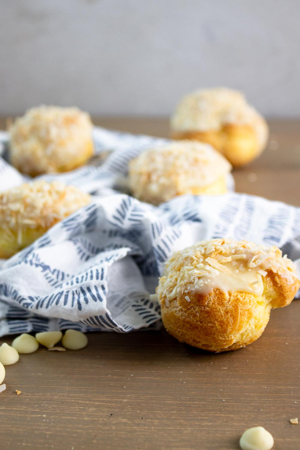 If you love cream puffs, put these orange coconut cream puffs on your to-do list. This homemade cream puffs recipe is made with a classic French choux pastry dough and filled with orange coconut cream and drizzled with white chocolate ganache. Perfect for your sweet tooth cravings.