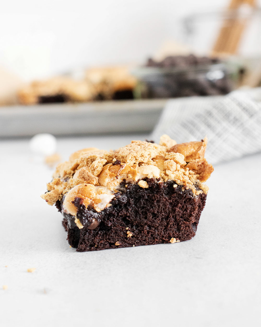 These easy and best Smores Brownies, topped with a crunchy streusel topping, are fudgy, chocolatey, gooey, and super delicious! Easy to make, portable and they can be frozen too.
