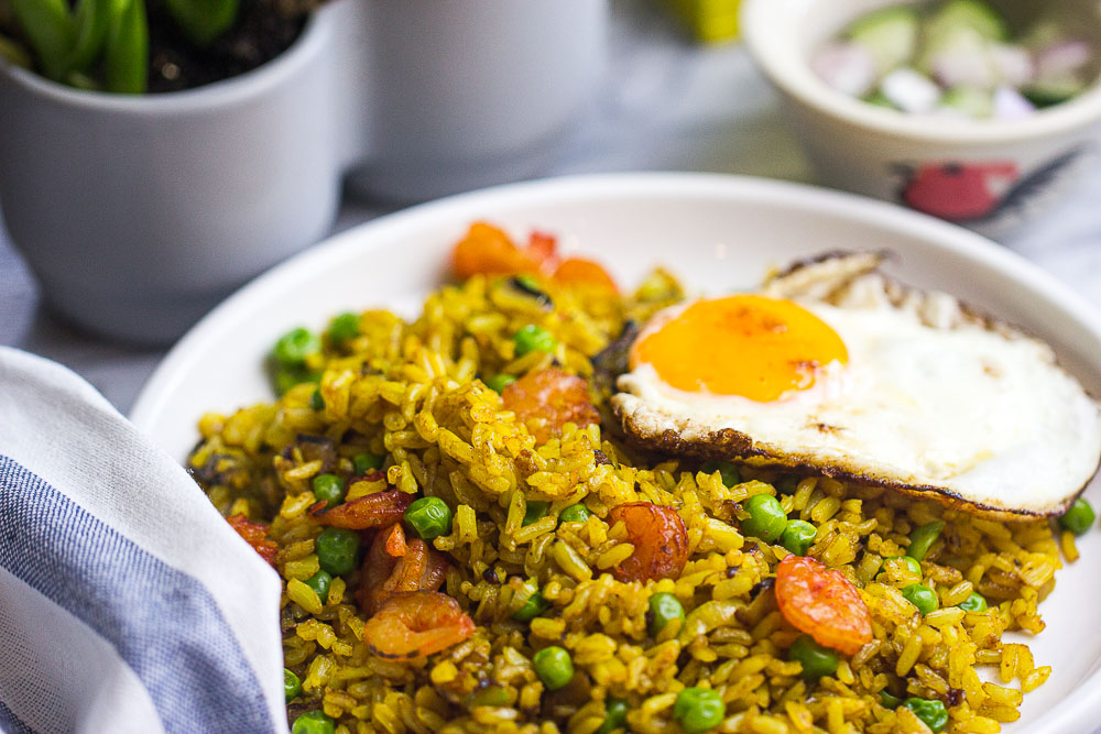 This skillet Turmeric Fried Rice (Indonesian Nasi Goreng Kunyit) recipe is a quick 30-minute meal that's easy to make, flavorful, and only requires one pan. Great weeknight meal the entire family will love!