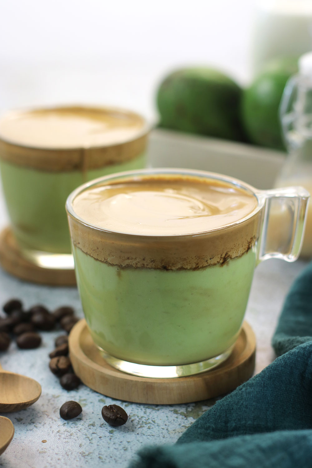 Creamy Avocado Dalgona Coffee is absolutely irresistible and a great way to make your morning coffee super special. The creamy fluffy sits on top of the avocado smoothie makes a great brunch drink. or an afternoon pick-me-up.