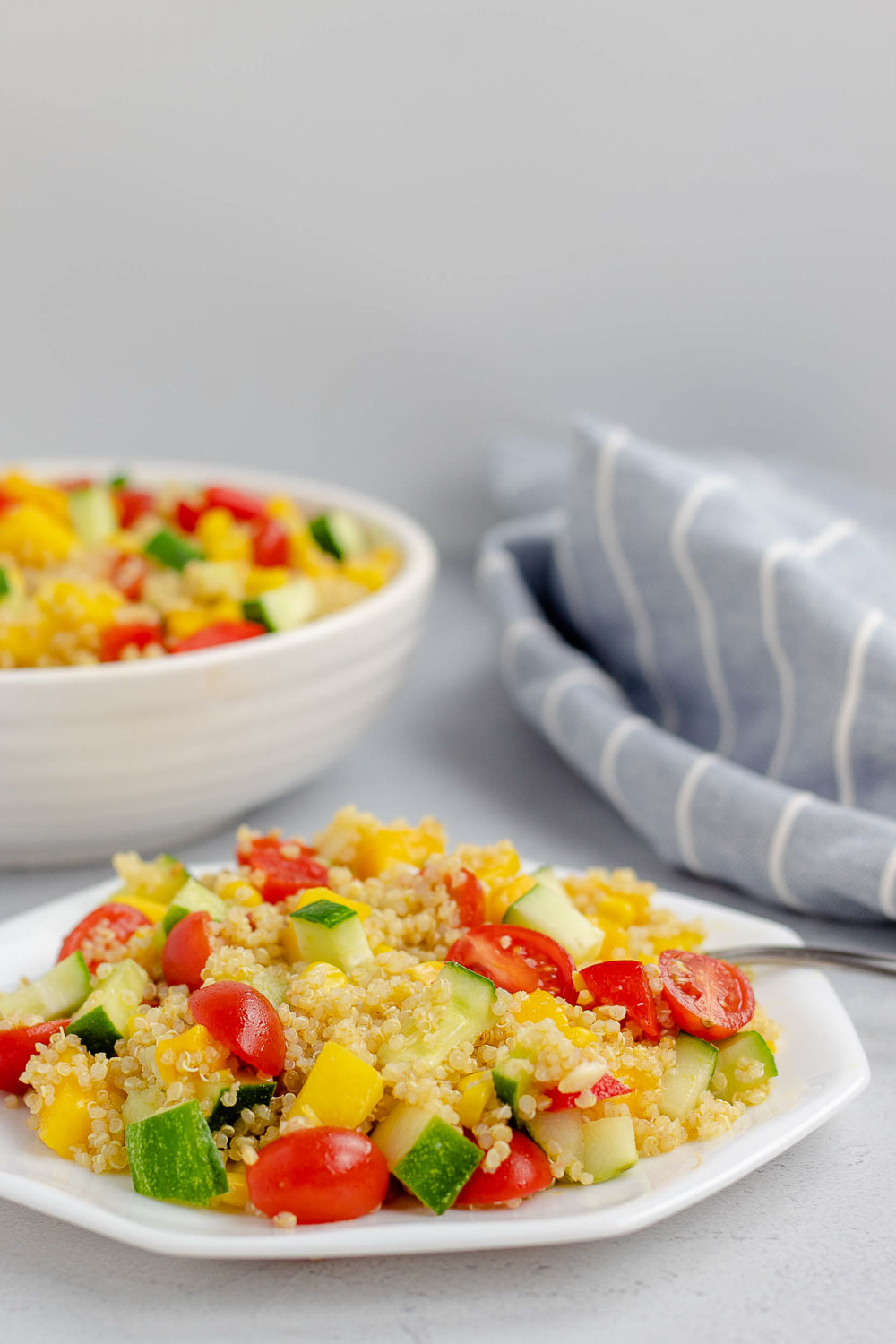 This 20-minute healthy mango quinoa salad is vegan, gluten-free, and perfect for entertaining. It will be your favorite easy lunch or summer salad that can be made ahead of time.