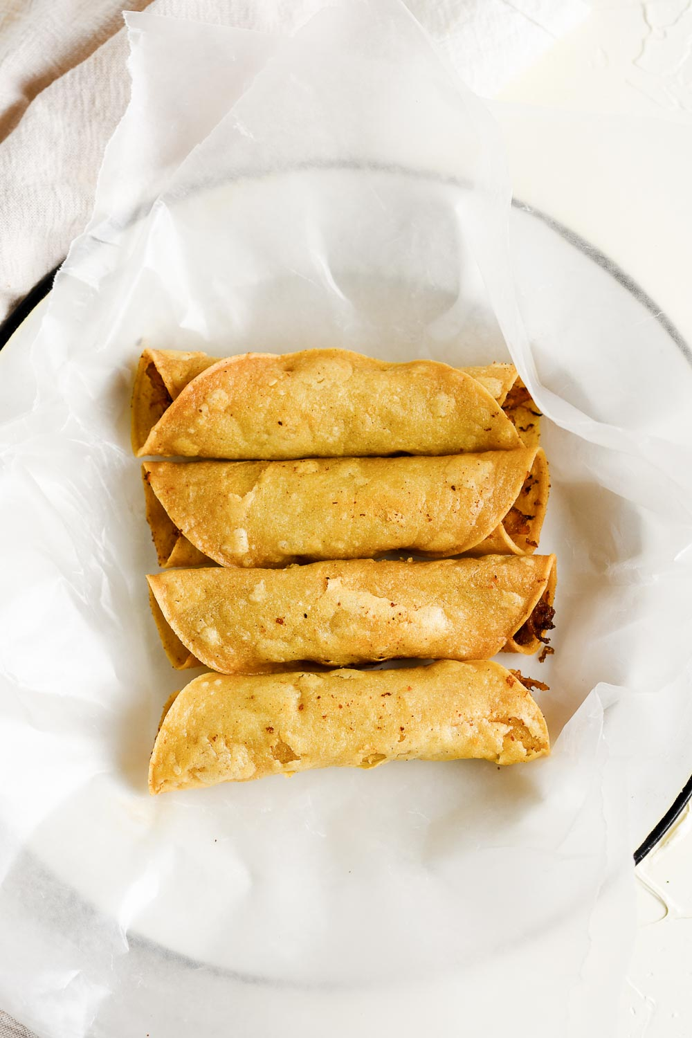 These chicken and potato taquitos are loaded with flavor and pack a bite so crisp. Super easy to make and always a hit. Try them now and enjoy with a glass of strawberry lychee soda!