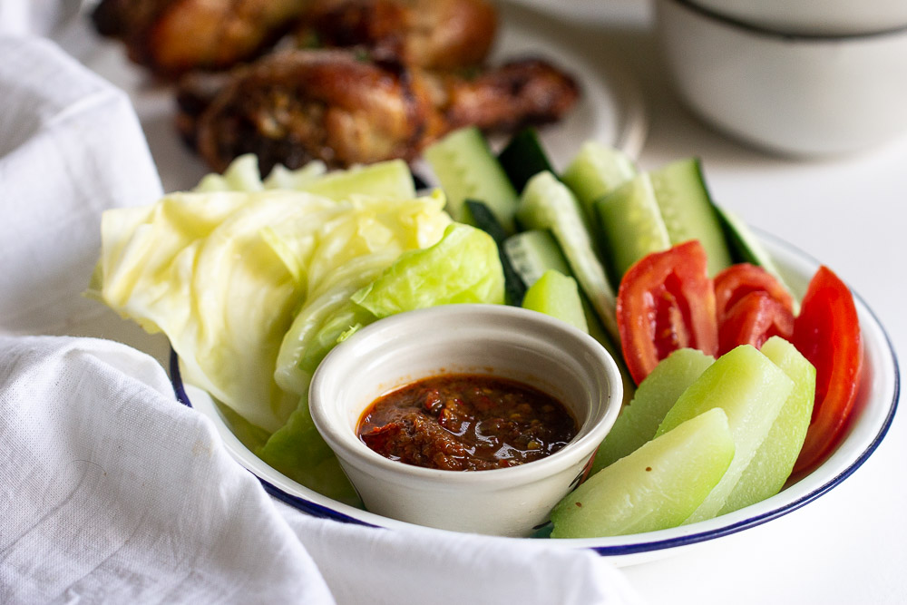 Learn how to prepare lalapan Sunda (Sundanese salad), Indonesian most popular vegetable platters that can be served cooked or raw with a side of sambal terasi and perfect with fried chicken.