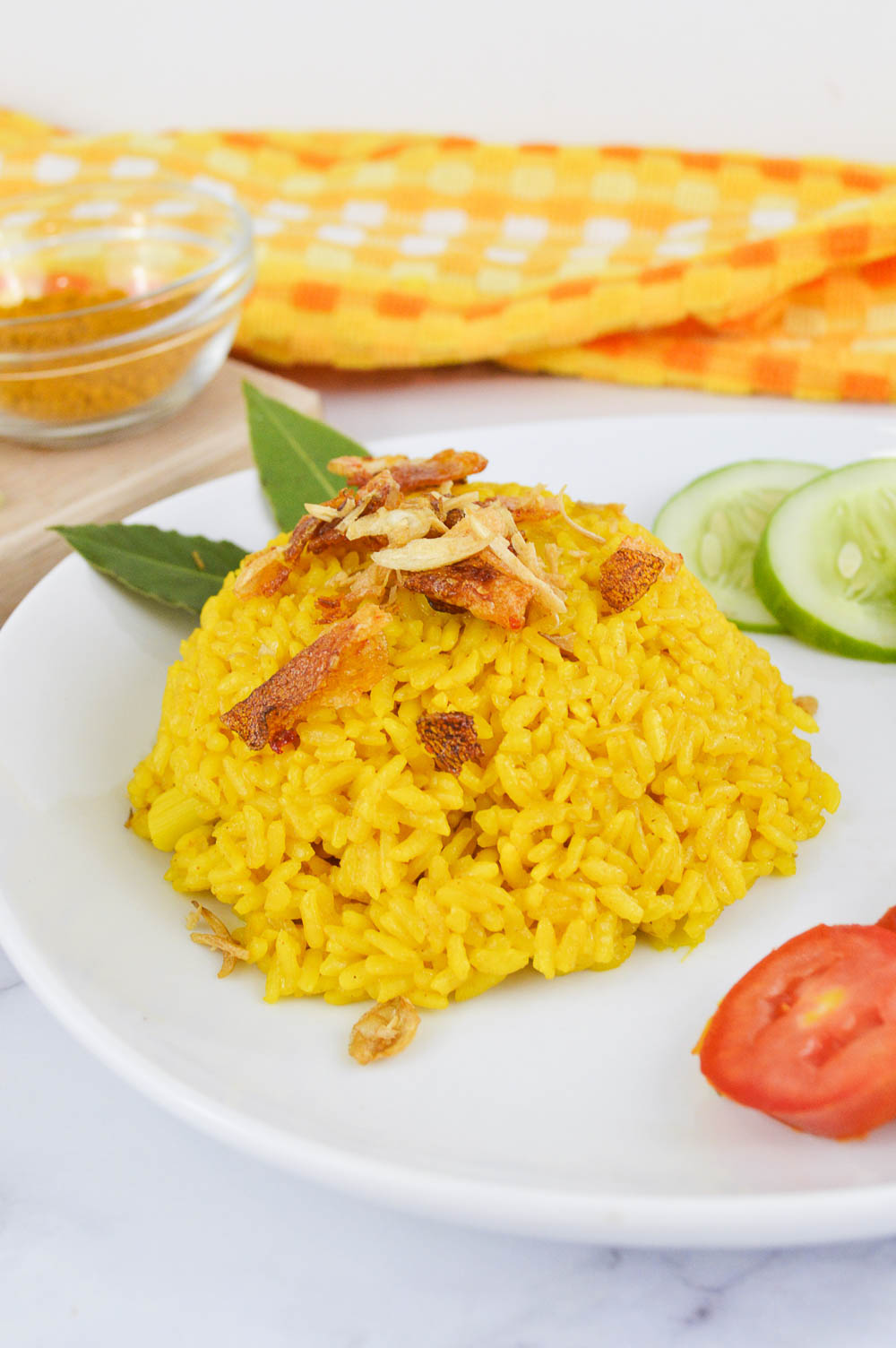 This Nasi Kuning (Indonesian Turmeric Rice) is rich and creamy, and the most authentic way to enjoy an Indonesian iconic dish.It's easy and simple to make with delicious flavor for your next quick meal. Today, learn how to make this turmeric rice with a rice cooker, on the stove, and in an Instant Pot.