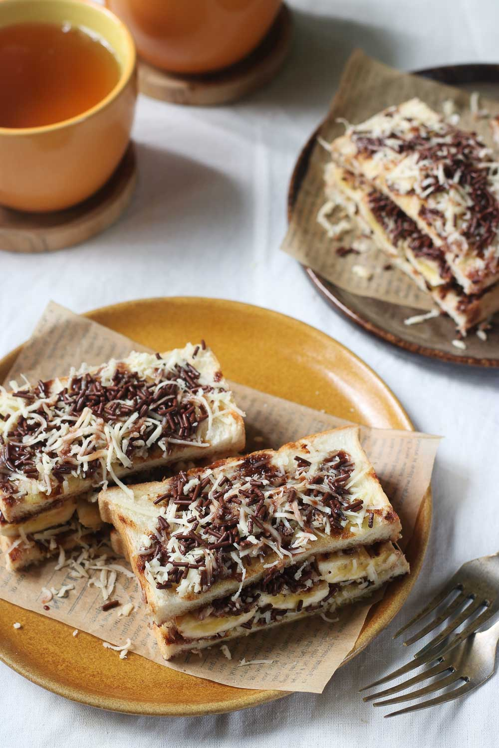 These grilled bananas/toast topped with chocolate and cheese which are also known as Indonesian roti pisang bakar makes a good late-night snack. They're so easy to make and perfect with a bowl of sweet peanut soup or black rice sweet porridge.
